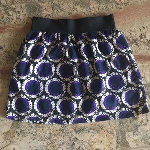 Black and purple mini skirt